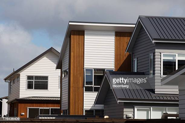 Newly constructed houses stand in the suburb of Hobsonville Point in Auckland New Zealand on Tuesday Aug 13 2013 New Zealand's growth rate is...