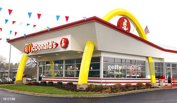 A newly constructed oldstyle McDonald's restaurant with the golden arches built through its facade is seen November 11 2002 in Willowbrook Illinois...