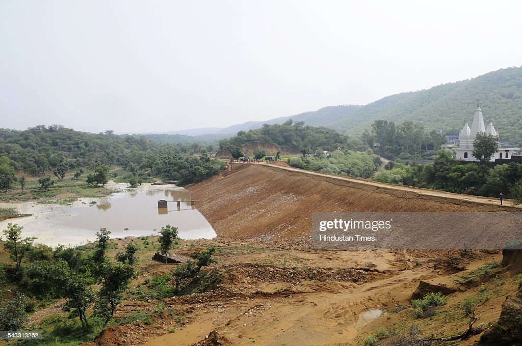 Newly constructed rain water harvesting dam at Jhirka on June 27, 2016 in Gurgaon, India. The Union minister for environment, forest and climate Prakash Javadekar conducted an aerial survey of the forest cover in Gurgaon and Mewat districts of Haryana, with a view to understand the Aravallis range. The minister said that a new policy will be framed to protect ecologically sensitive Aravallis taking into accounts all the previous judgments related to the issue.