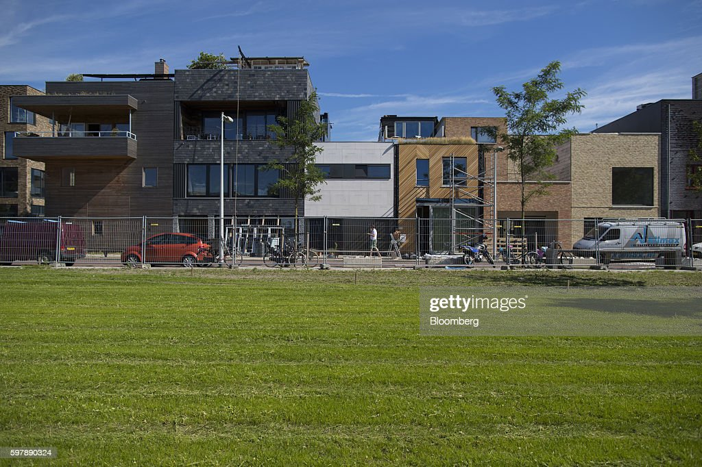 Newly constructed residential property stands beside green space in the Noord district of Amsterdam Netherlands on Thursday Aug 25 2016 The district...