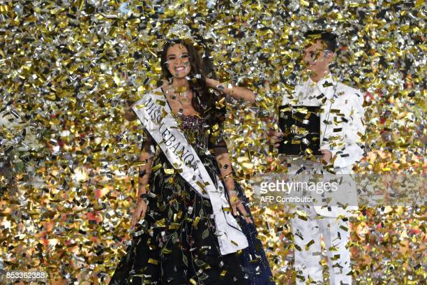 TOPSHOT Newly crowned Miss Lebanon 2017 Perla Helou reacts after being elected at Casino Du Liban in Jounieh north of Beirut on September 24 2017 /...