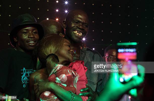 Newly crowned 'Mr Ugly' Zimbabwe Maison Sere celebrates his victory with members of the audience during the 'Ugliest Man' contest in Harare Zimbabwe...