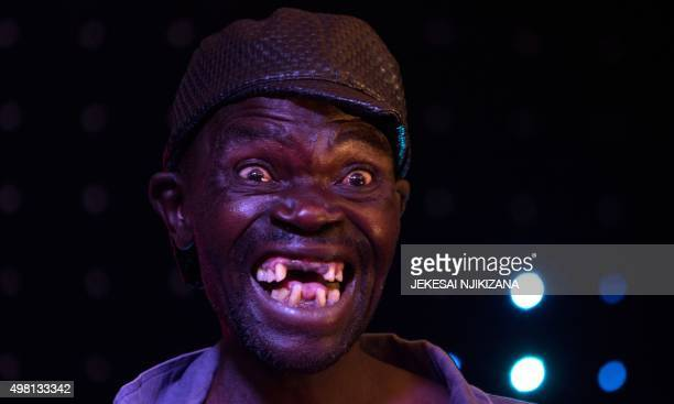 Newly crowned 'Mr Ugly' Zimbabwe Maison Sere poses during the 'Ugliest Man' contest in Harare Zimbabwe on November 20 2015 A 42yearold unemployed man...
