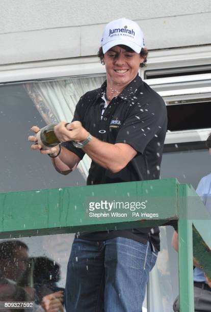 Newly crowned US Open Champion Rory McIlroy sprays champagne during the celebration at Holywood Golf Club County Down