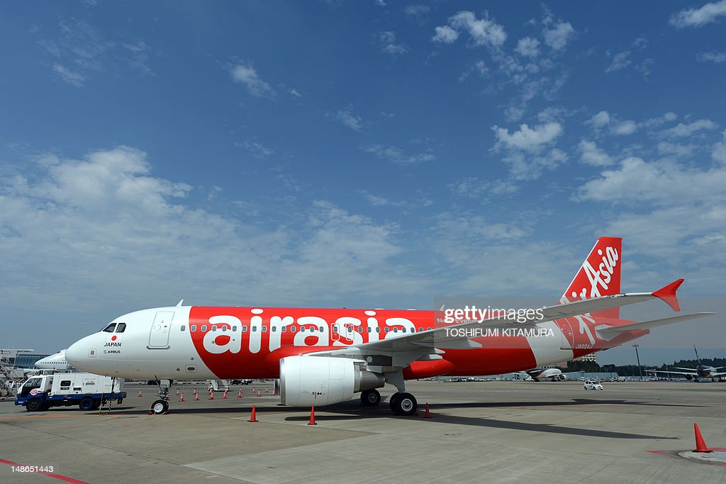 Newly designed Air Asia Japan's Airbus A320 is on display during its press preview at the Narita International airport on July 19 2012 Air Asia Japan...