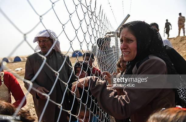 Newly displaced Iraqi's who fled from the city of Mosul Iraq's last major Islamic State group stronghold are reunited with their relatives who came...