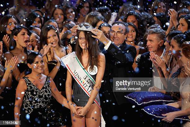 Newly elected 18yearold student Silvia Battisti is crowned with the title of Miss Italy 2007 by TV presenter Pippo Baudo during the final of the...