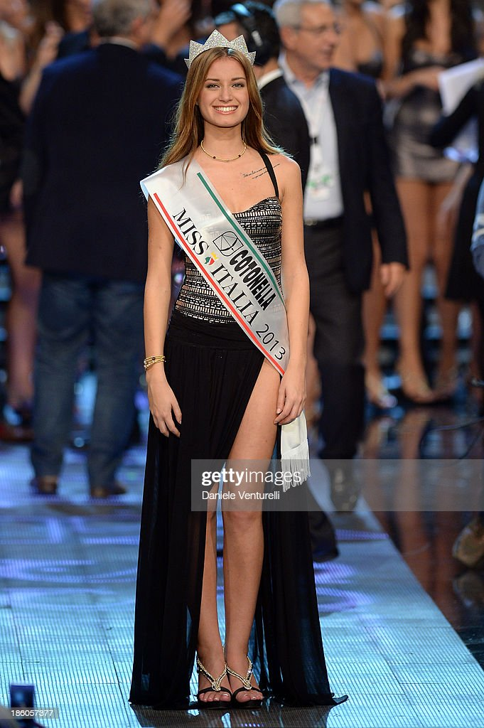 Newly elected 19-year-old Giulia Arena is crowned with the title of Miss Italia 2013 during the final of the beauty pageant contest 2013 Miss Italia beauty pageant at the Pala Arrex on October 27, 2013 in Jesolo, Italy.