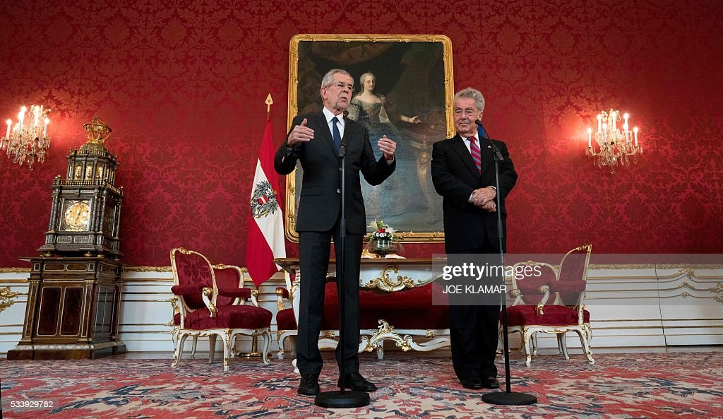 Newly elected Austrian President Alexander Van der Bellen (L) speaks to journalists after meeting with Austrian President Heinz Fischer (R) at the presidential palace in Vienna, on May 24, 2016. / AFP / JOE