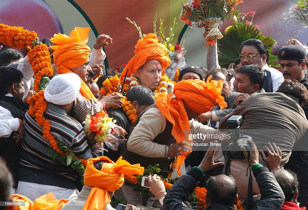 Newly elected BJP President Rajnath Singh being facilitated by supporters at BJP Headquarter, on January 23, 2012 in New Delhi, India. Rajnath Singh succeeds Nitin Gadkari, who decided against contesting for a second term following charges of alleged corruption.