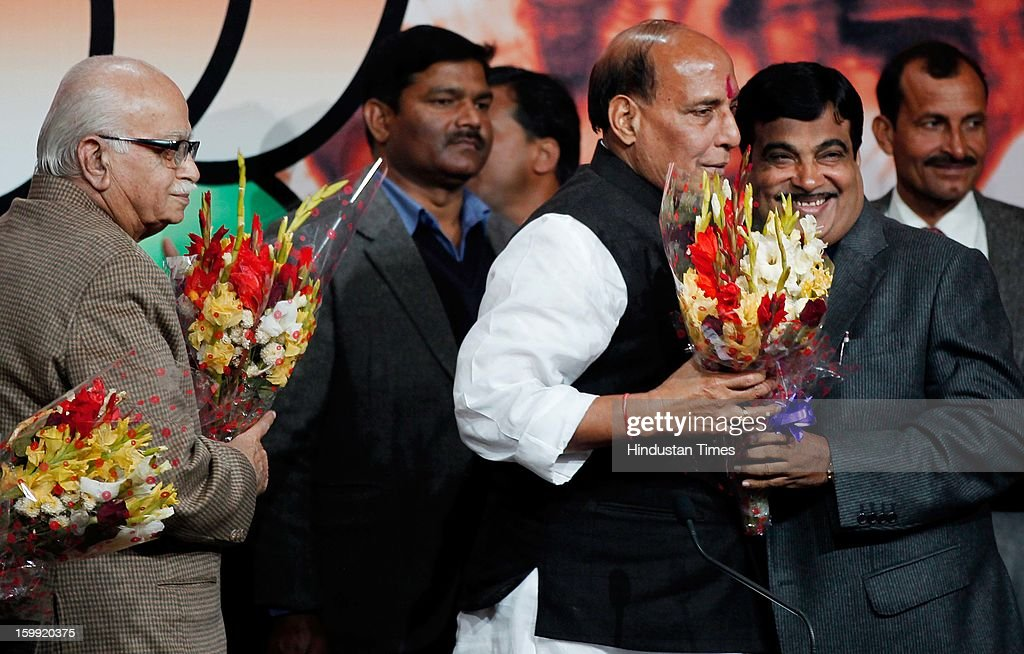 Newly elected BJP President Rajnath Singh congratulated by Former BJP President Nitin Gadkari while Senior BJP Leader L K Advani looks on at BJP Headquarter, on January 23, 2012 in New Delhi, India. Rajnath Singh succeeds Nitin Gadkari, who decided against contesting for a second term following charges of alleged corruption.