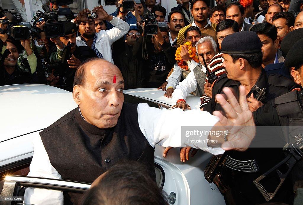 Newly elected BJP President Rajnath Singh surrounded by the supporters at BJP Headquarter, on January 23, 2012 in New Delhi, India. Rajnath Singh succeeds Nitin Gadkari, who decided against contesting for a second term following charges of alleged corruption.