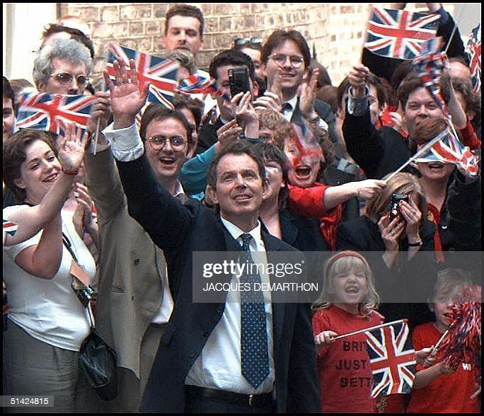 Newly elected British Prime Minister Tony Blair (C) waves at supporters 02 May upon his arrival at No. 10 Downing Street in London, his new residence after winning the 01 May general elections against outgoing Prime Minister John Major.