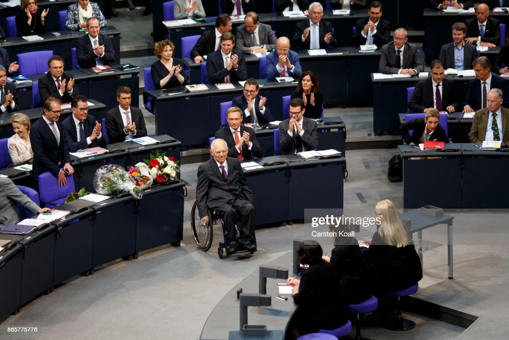 Newly elected Bundestag president Wolfgang Schaeuble moves to the President seat at the opening session of the new Bundestag on October 24, 2017 in Berlin, Germany. Today's is the first session since German federal elections in September. The new Bundestag is markedly different from the previous one, as instead of four parties the new parliament contains six, including approximately 90 parliamentarians of the right-wing Alternative for Germany (AfD). Meanwhile the German Christian Democrats (CDU/CSU), the Free Democratic Party (FDP) and the German Greens Party (Buendnis 90/Die Gruenen) are continuing their negotiations for forming a government coalition.