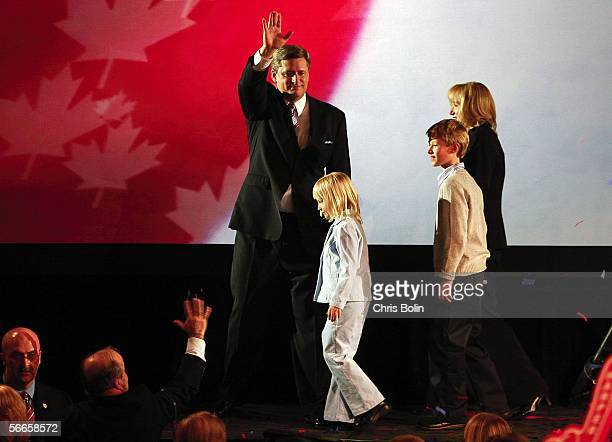 Newly elected Canadian Prime Minister Stephen Harper leader of the Conservative Party waves to supporters as he celebrates his win with his wife...