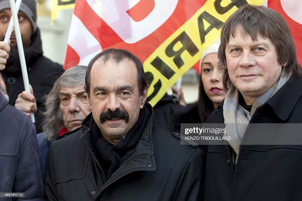 Newly elected CGT Secretary General Philippe Martinez and his predecessor Bernard Thibault stand together as they demonstrate during a global day of...
