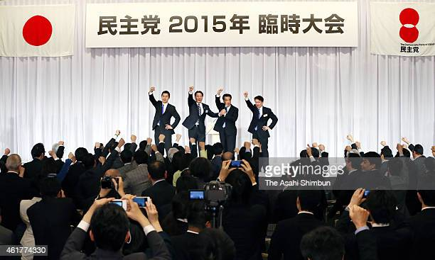 Newly elected Democratic Party President Katsuya Okada raise his fist along with candidates Goshi Hosono and Akira Nagatsuma and outgoing president...