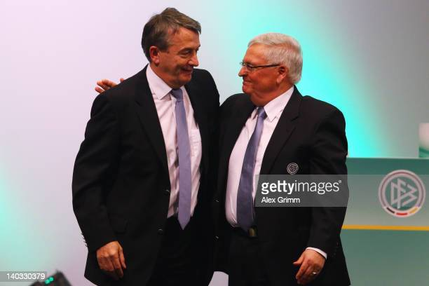 Newly elected DFB president Wolfgang Niersbach is hugged by predecessor Theo Zwanziger during the DFB federal meeting at Steigenberger Airport Hotel...