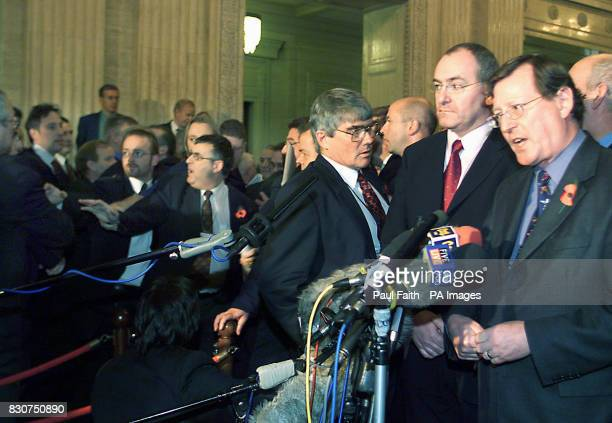 Newly elected First Minister David Trimble and Deputy First Minister Mark Durkan speak to the press in the Great Hall at Stormont as rival Unionists...