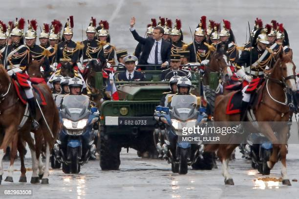 Newly elected French president Emmanuel Macron parades in a military car on the Champs Elysees avenue after his formal inauguration ceremony on May...