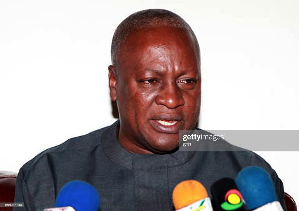 Newly elected Ghanaian President John Dramani Mahama (C), candidate of the ruling National Democratic Congress party, who replaced the late President John Atta-Mills after his death in July delivers a speech after meeting with Former Nigerian President and head of the Economic Community of West African States (ECOWAS) monitoring team for Ghana's 2012 election Olusegun Obasanjo (L) in Accra on December 9, 2012. Obasanjo paid Mahama a visit ahead of the final results announcement for Ghana's just concluded presidential and parliamentary elections that were acclaimed by the ECOWAS observers as 'peaceful and transparent.' Mahama held a slight edge over his main rival as vote counting wrapped up on December 9 after high-stakes presidential polls in the emerging west African country, local media said. AFP PHOTO / STRINGER