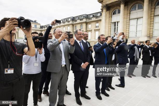 Newly elected group president Richard Ferrand and some other members of parliament of the La Republique En Marche party attend a family photo of...