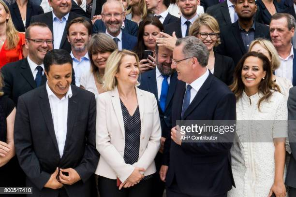 Newly elected group president Richard Ferrand jokes with MP Barbara Pompili as they attend a group picture of the La Republique En Marche party newly...