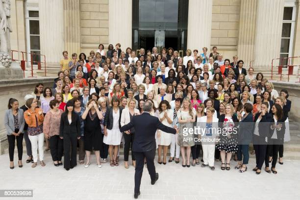 Newly elected group president Richard Ferrand poses with all the women elected members of parliament of La Republique En Marche party for picture...