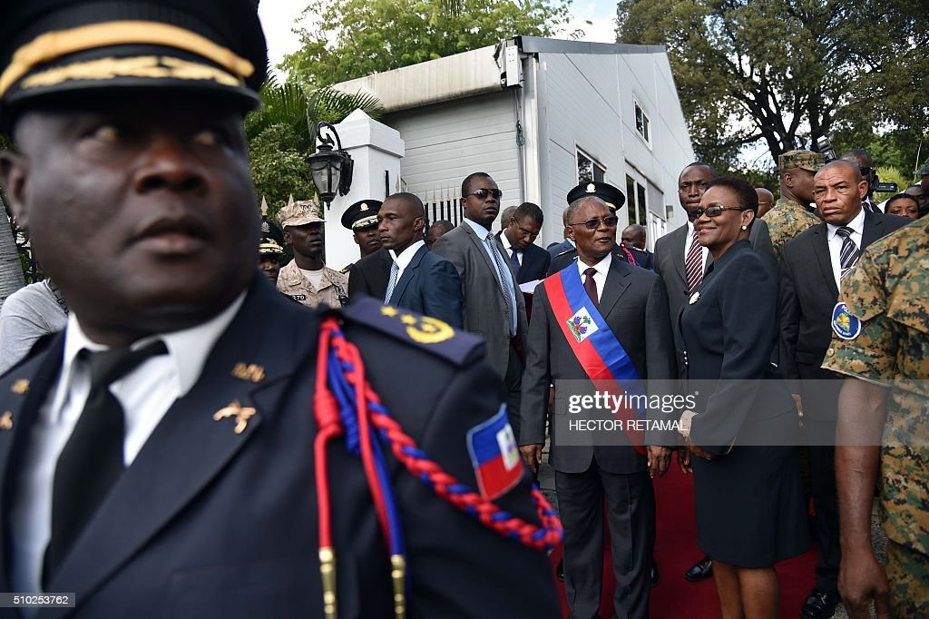 Newly elected Haitian Provisional President Jocelerme Privert arrives at the installation ceremony in the National Palace in Port-au-Prince on February 14, 2016. Haitian lawmakers early Sunday elected Jocelerme Privert as the troubled country's interim president to fill a power vacuum following the departure of Michel Martelly, after a vote to choose his successor was postponed over fears of violence. Privert, 62, a senator and president of the National Assembly, was chosen on the second round of balloting after a lengthy session that stretched overnight Saturday to Sunday. RETAMAL