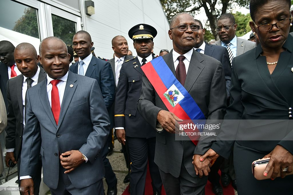 Newly elected Haitian Provisional President Jocelerme Privert leaves after the installation ceremony in the National Palace in Port-au-Prince on February 14, 2016. Haitian lawmakers early Sunday elected Jocelerme Privert as the troubled country's interim president to fill a power vacuum following the departure of Michel Martelly, after a vote to choose his successor was postponed over fears of violence. Privert, 62, a senator and president of the National Assembly, was chosen on the second round of balloting after a lengthy session that stretched overnight Saturday to Sunday. RETAMAL