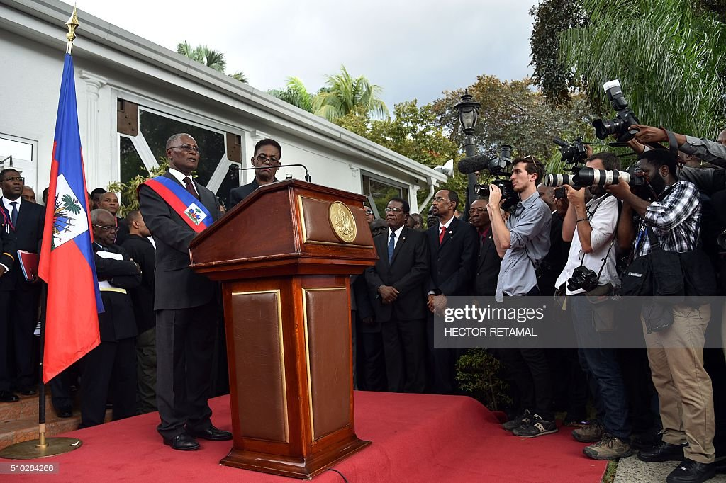 Newly elected Haitian Provisional President Jocelerme Privert speaks at the installation ceremony in the National Palace in Port-au-Prince on February 14, 2016. Haitian lawmakers early Sunday elected Jocelerme Privert as the troubled country's interim president to fill a power vacuum following the departure of Michel Martelly, after a vote to choose his successor was postponed over fears of violence. Privert, 62, a senator and president of the National Assembly, was chosen on the second round of balloting after a lengthy session that stretched overnight Saturday to Sunday. RETAMAL