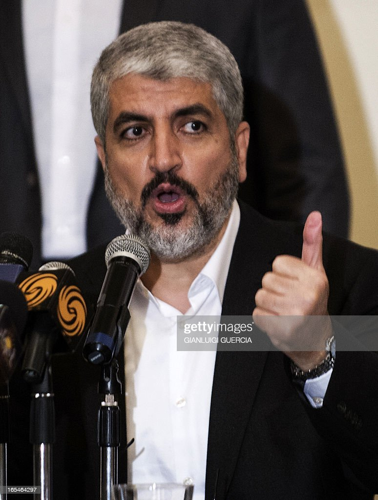 Newly elected Hamas political leader Khaled Meshaal speaks at political conference on Palestine on April 4, 2013 in Cairo. Meshaal's reelection as head of the Islamist Hamas movement was officially confirmed on April 2, drawing a cautious welcome from the rival Fatah movement which rules the West Bank.