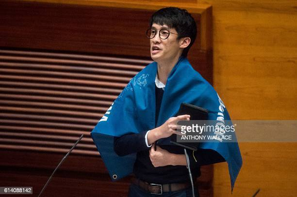Newly elected lawmaker Baggio Leung wears a flag reading 'Hong Kong is not China' as he takes the Legislative Council Oath at the first meeting of...