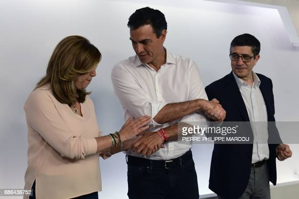 Newly elected leader and former leader of Spanish Socialist Party Pedro Sanchez shakes hands with fellow candidates to the party leadership president...