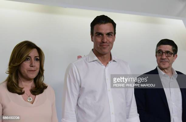 Newly elected leader and former leader of Spanish Socialist Party Pedro Sanchez stands between fellow candidates to the party leadership president of...