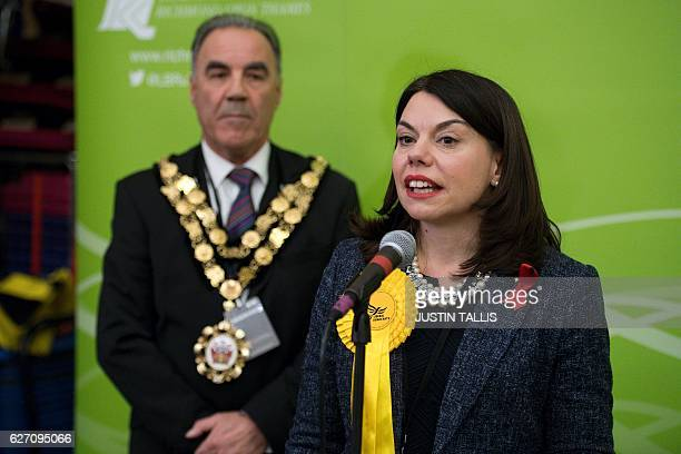 Newly elected Liberal Democrat MP for Richmond Park Sarah Olney speaks on stage after winning her seat in Richmond southwest London on December 2...