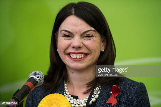 Newly elected Liberal Democrat MP for Richmond Park Sarah Olney smiles on stage after winning her seat in Richmond southwest London on December 2...