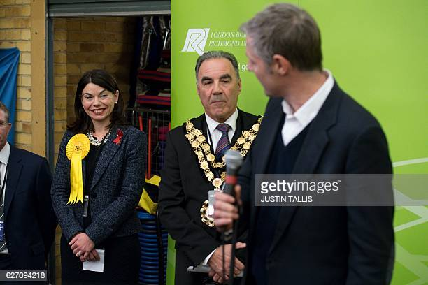 Newly elected Liberal Democrat MP for Richmond Park Sarah Olney listens to Independent candidate Zac Goldsmith speaking after Olney won her seat in...