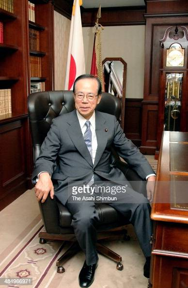 Newly elected Liberal Democratic Party President Yasuo Fukuda poses for photographs in the president's chair at the party headquarters on September...