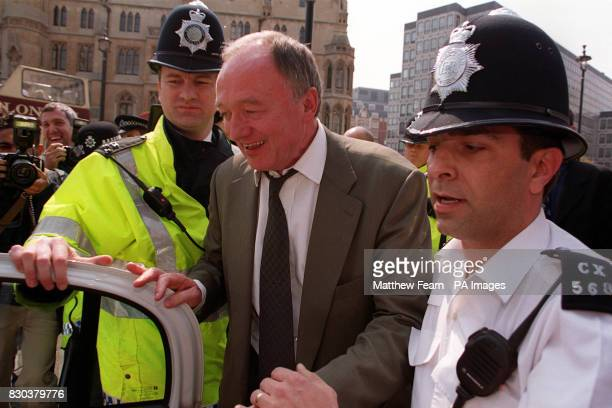 Newly elected London Mayor Ken Livingstone is escorted by police after leaving the Queen Elizabeth II Conference Centre in London where the result of...
