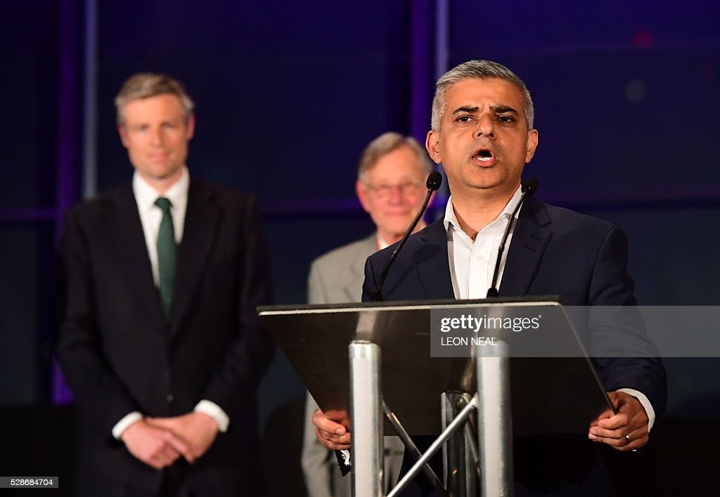 Newly elected London Mayor Sadiq Khan (Foreground) addresses the media following his election victory at City Hall in central London on May 7, 2016. London became the first EU capital with a Muslim mayor Friday as Sadiq Khan won the election that saw his opposition Labour party suffer nationwide setbacks. / AFP / LEON