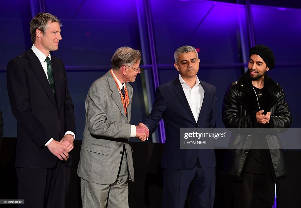 Newly elected London Mayor Sadiq Khan (2nd R) is congratulated as it is announced that he has won the election at City Hall in central London on May 7, 2016. London became the first EU capital with a Muslim mayor Friday as Sadiq Khan won the election that saw his opposition Labour party suffer nationwide setbacks. / AFP / LEON