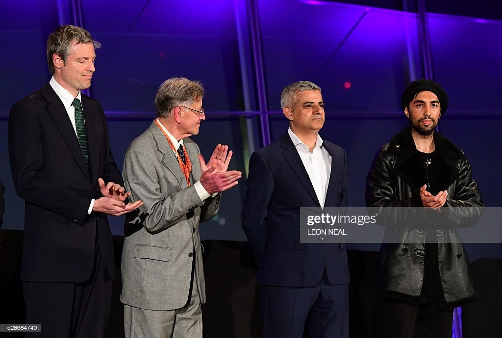 Newly elected London Mayor Sadiq Khan (2nd R) is congratulated by other candidates including Conservative Pary candidate Zac Goldsmith (L) following his election victory at City Hall in central London on May 7, 2016. London became the first EU capital with a Muslim mayor Friday as Sadiq Khan won the election that saw his opposition Labour party suffer nationwide setbacks. / AFP / LEON