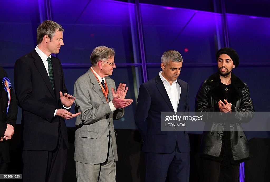 Newly elected London Mayor Sadiq Khan (2nd R) is congratulated by other candidates following the announcement of his victory at City Hall in central London on May 7, 2016. London became the first EU capital with a Muslim mayor Friday as Sadiq Khan won the election that saw his opposition Labour party suffer nationwide setbacks. / AFP / LEON
