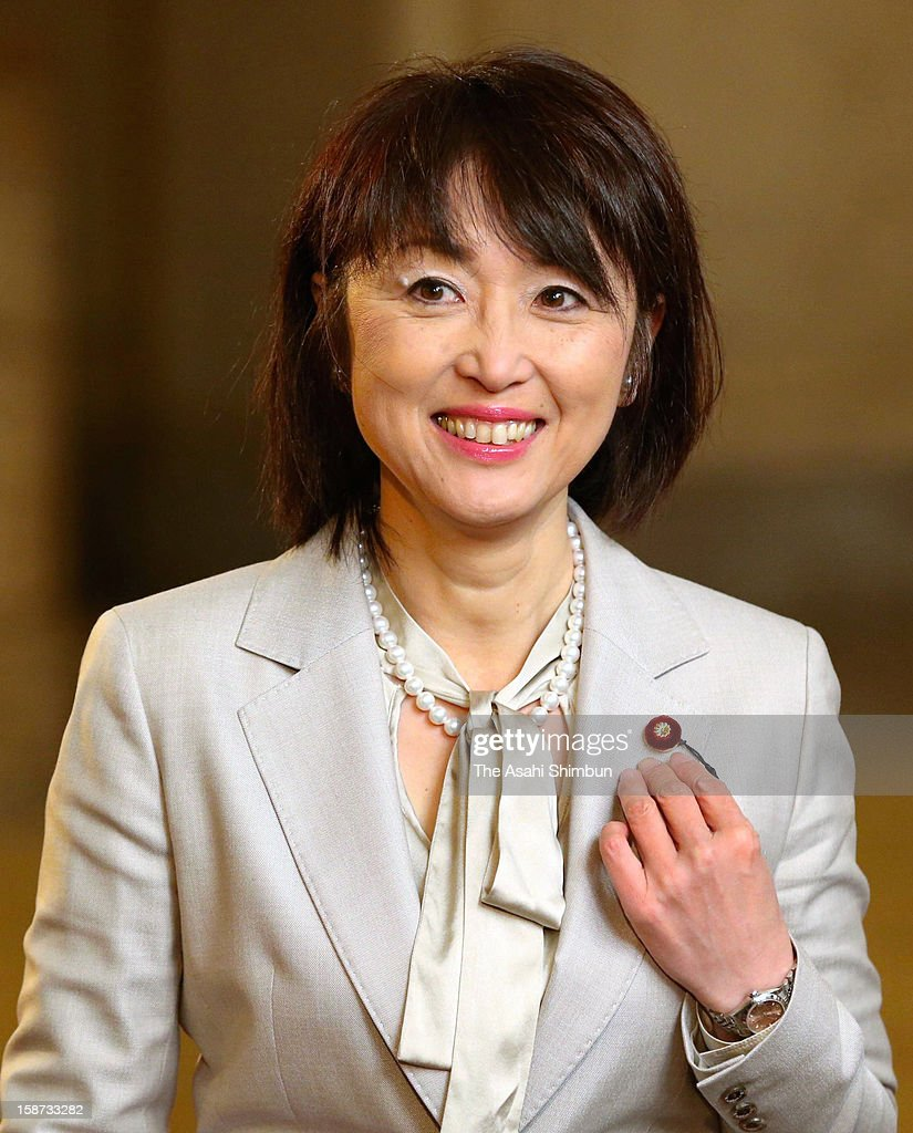 Newly elected lower house lawmaker Yuko Nakagawa, wife of former Finance Minister Shoichi Nakagawa of the Liberal Democratic Party poses for photogrpahs at the diet building on December 26, 2012 in Tokyo, Japan. Liberal Democratic Party president Shinzo Abe becomes Japan's 96th prime minister, seventh in six years.