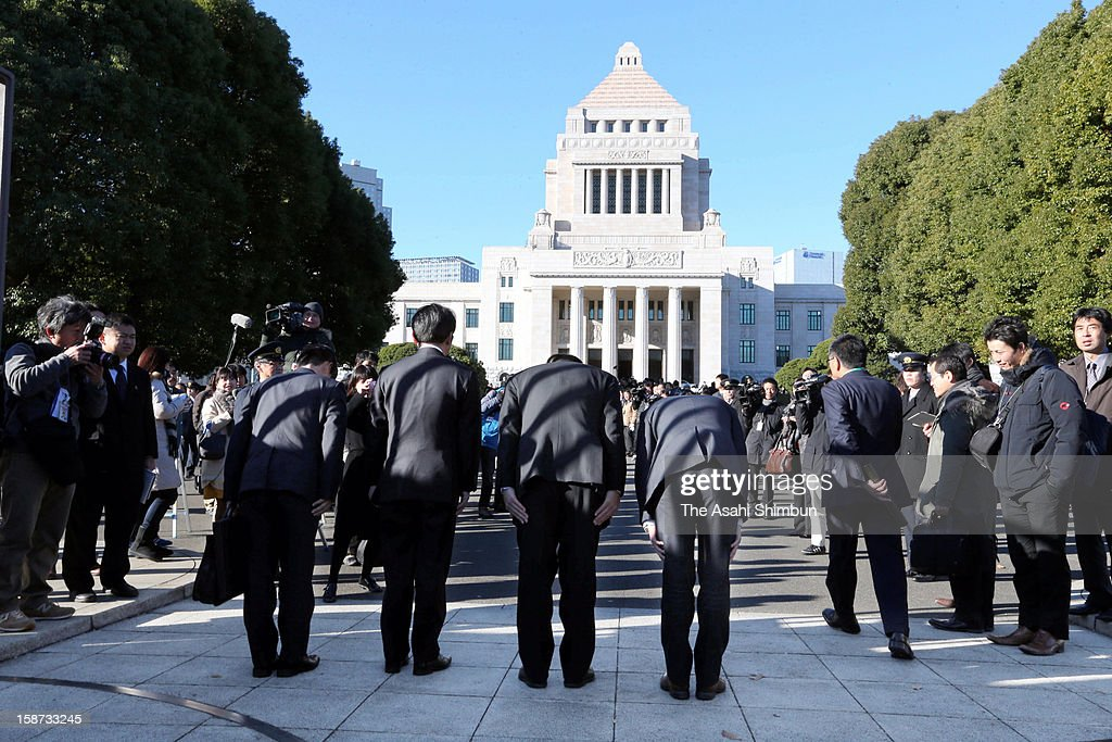 Newly elected lower house lawmakers bow to the diet building on December 26, 2012 in Tokyo, Japan. Liberal Democratic Party president Shinzo Abe becomes Japan's 96th prime minister, seventh in six years.