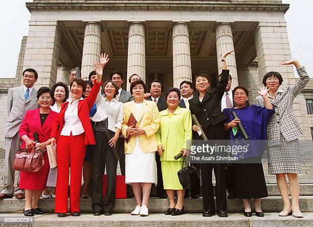 Newly elected lower house lawmakers of the Social Democratic Party pose for photographs with the leader Takako Doi as the 148th Special session of...
