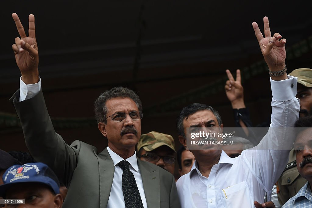 Newly elected mayor of Karachi of the influential Muttahida Qaumi Movement party Waseem Akhtar and his deputy mayor Arshad Vohra flash victory signs...