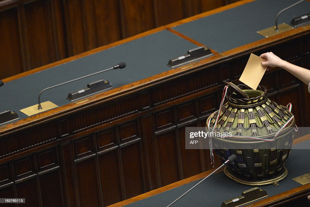 A newly elected member of parliament casts her ballot during the first session of Italian lower-house on March 15, 2013 in Rome. General election in Italy took place on February 26 but as a majority in both chambers of parliament is required to form a government, Italy is left in a state of limbo with a hung parliament that is unprecedented in its post-war history. AFP PHOTO / ANDREAS SOLARO