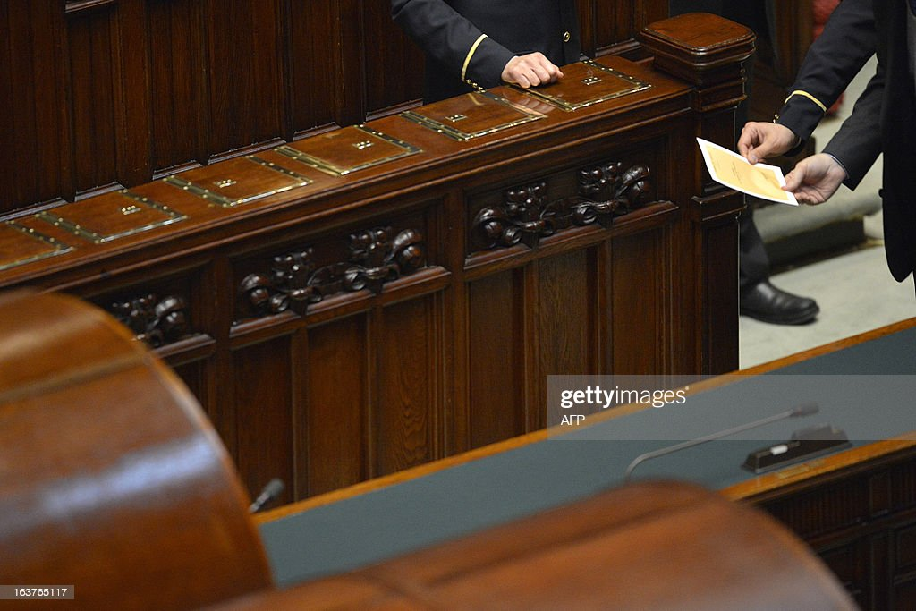 A newly elected member of parliament casts his ballot during the first session of Italian lower-house on March 15, 2013 in Rome. General election in Italy took place on February 26 but as a majority in both chambers of parliament is required to form a government, Italy is left in a state of limbo with a hung parliament that is unprecedented in its post-war history.